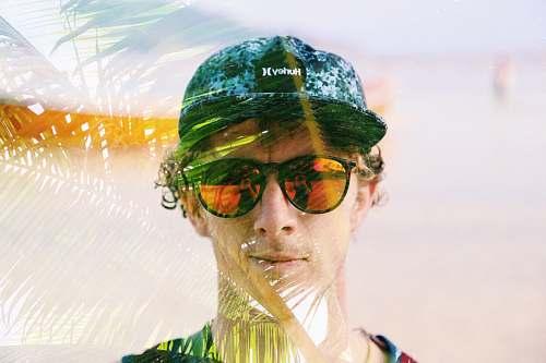 person man wearing black framed sunglasses human