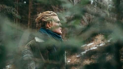 human man wearing blue scarf during daytime blonde