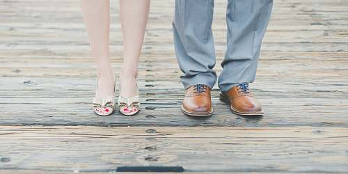 photo person man wearing brown leather oxford shoes beside woman wearing gold open-toe sandals shoes free for commercial use images