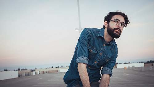 person man wearing denim sport shirt and sunglasses on concrete flooring denim