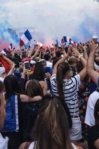 human people gathering holding France flags crowd