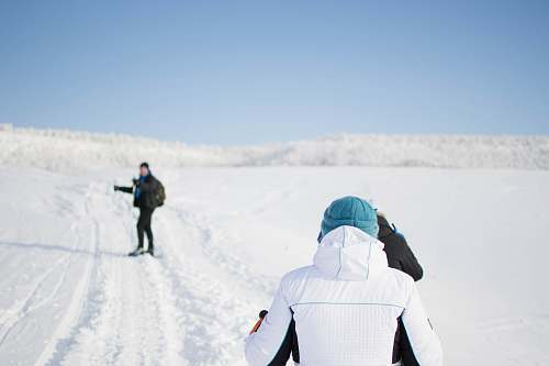 person people on snow field human