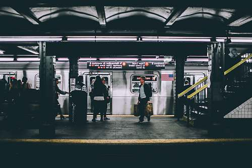 subway people standing near train train station