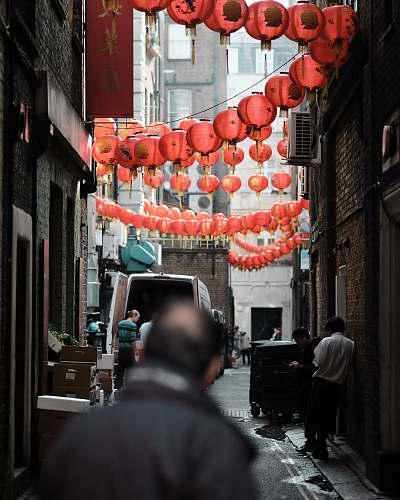 lamp people walking in the street lantern