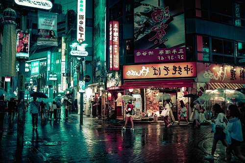japan people walking near buildings at night city