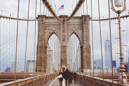 person people walking on Brooklyn Bridge during daytime bridge