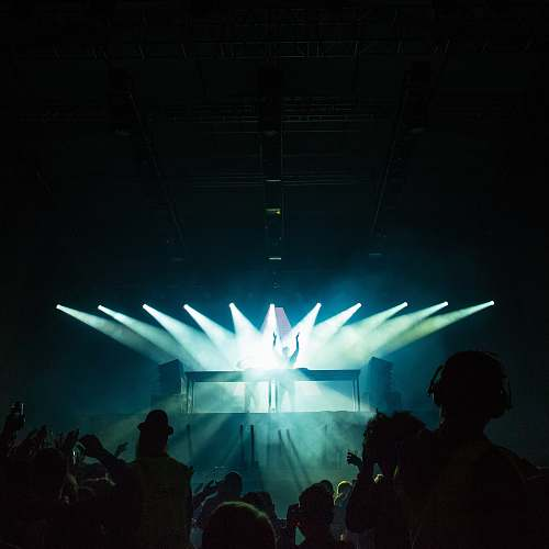 photo person person standing under stage lights facing crowd human free for commercial use images
