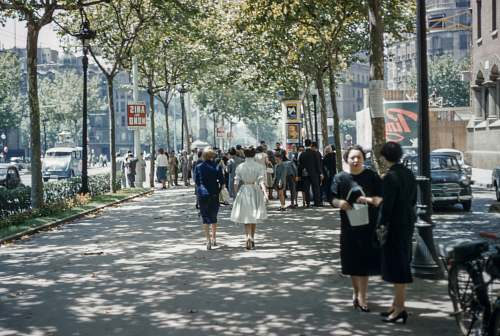 human several people walking on road under blue sky vintage