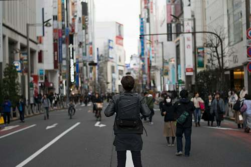 person shallow focus photography of person carrying backpack human