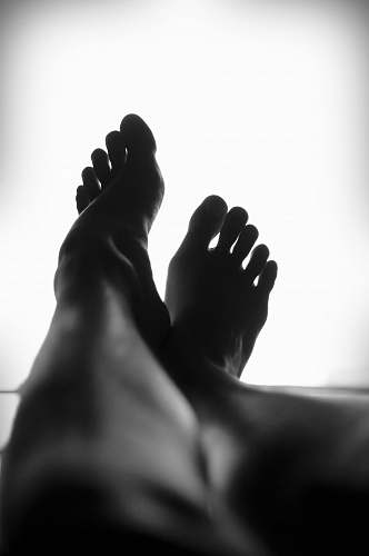 black-and-white silhouette of person's feet against white background legs