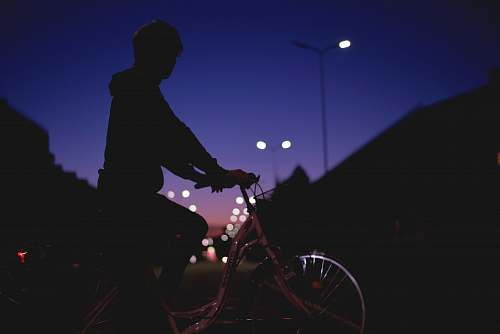 photo bicycle silhouette person riding on bike at night bike free for commercial use images