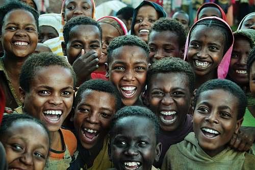 person smiling children gathering taken during daytime tribe