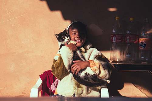 campinas smiling girl hugging cat leaning on wall brazil