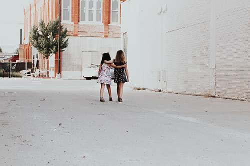 person two girls walking on street human