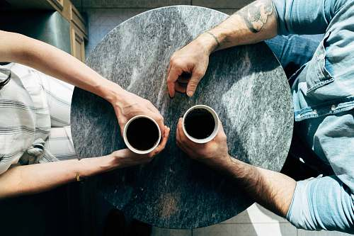 coffee two man and woman holding cups on tables couple