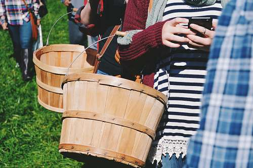 person two person fall in line while holding basket human