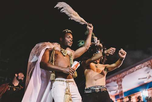 person two topless men performing new orleans
