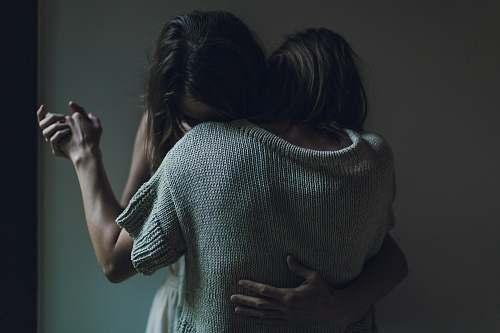 human two women hugging each other woman