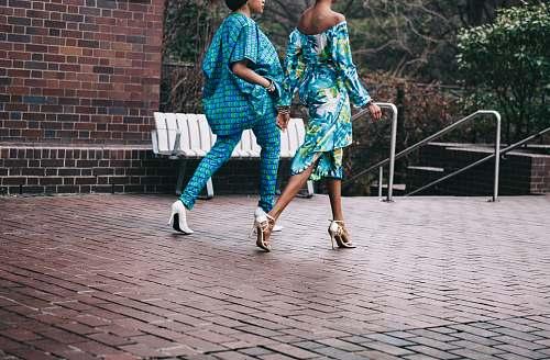 woman two women in teal romper pants fashion