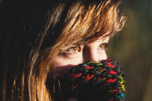 person woman covering her multicolored knit mask human