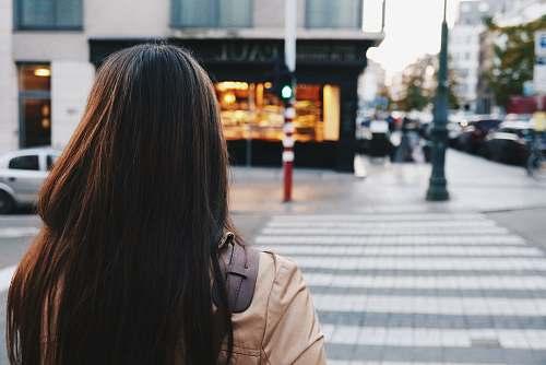 person woman crossing street road