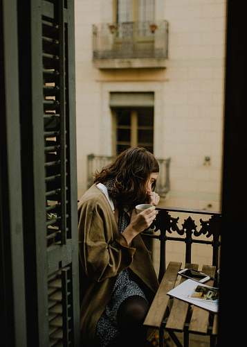 human woman drinking white sitting on bench person