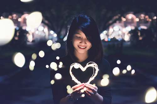 woman woman holding lit heart love