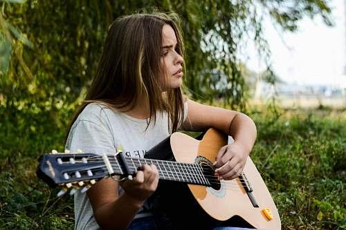 music woman playing gitar guitar