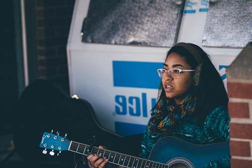 female woman playing guitar guitar