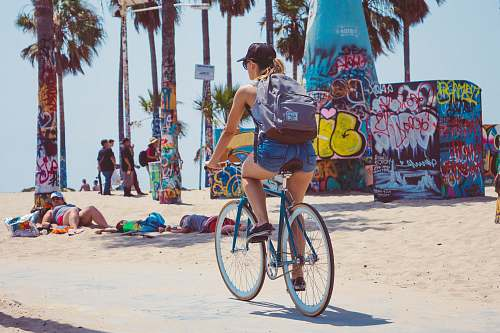 photo person woman riding on bicycle bike free for commercial use images
