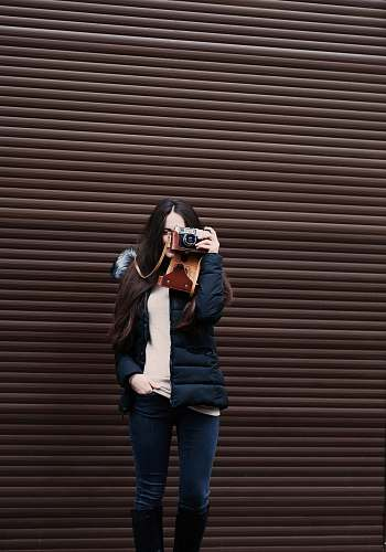 person woman standing holding camera taking photo human