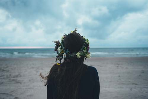 woman woman standing near seashore during daytime sea