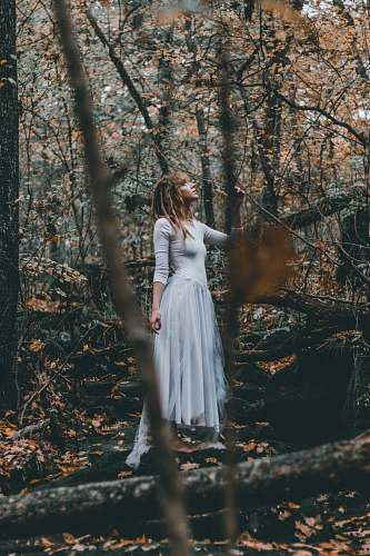 person woman standing on forest trees human