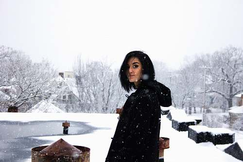 person woman wearing black shirt standing under snow weather human