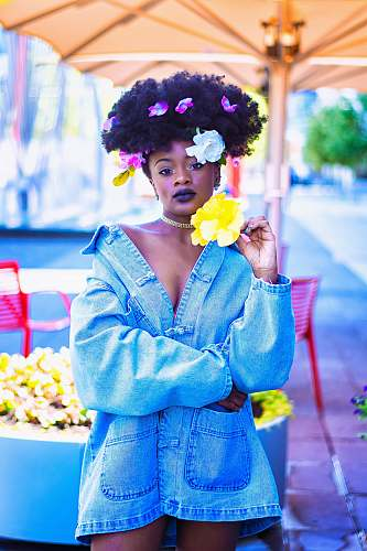 human woman wearing blue denim jacket with flowers on hair person