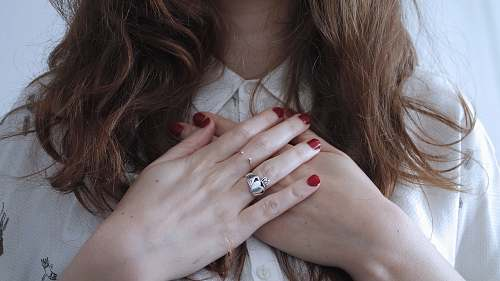 person woman wearing silver-colored ring hands