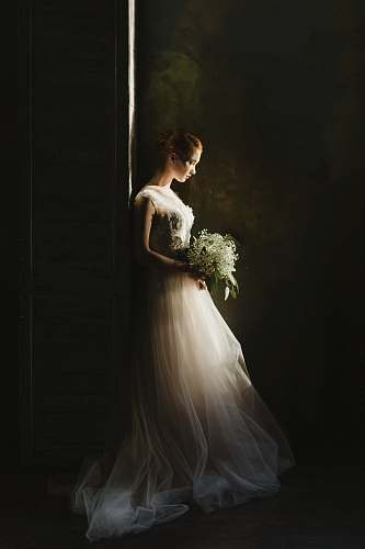 wedding woman wearing wedding gown white holding bouquet portrait