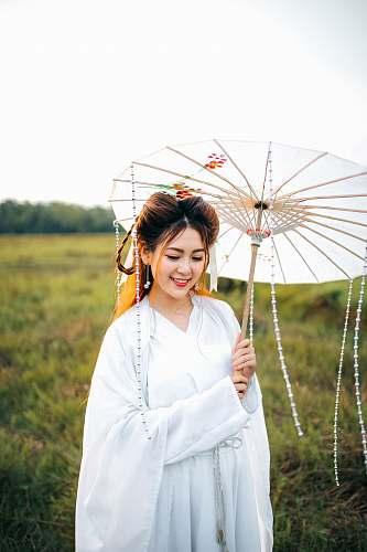 person woman wearing white kimono dress and holding white umbrella human