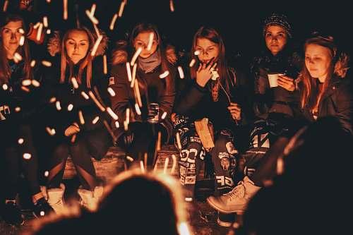 person women near bonfire at night human