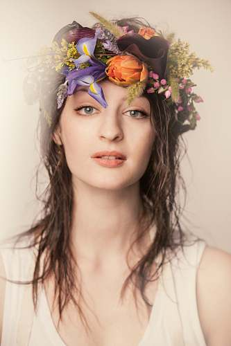 human women wearing floral headdress person