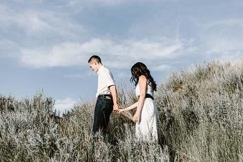 people couple walks of grassy field human