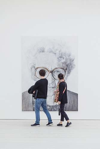 people man and woman looking at woman's painting human
