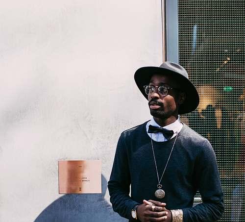 people man in black sweatshirt and hat hat
