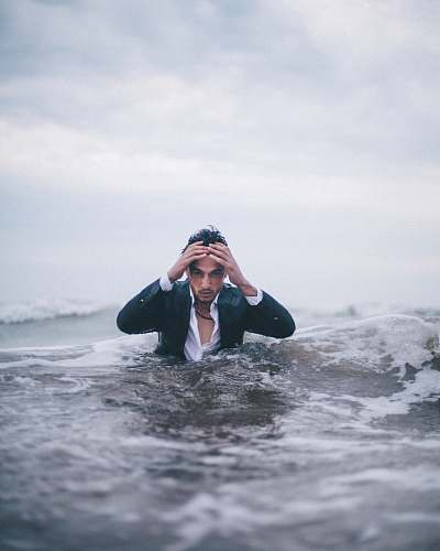 people man on body of water during daytime human
