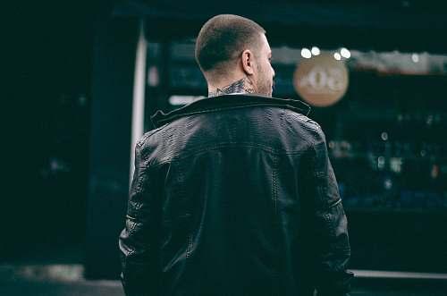 people man wearing black leather jacket human