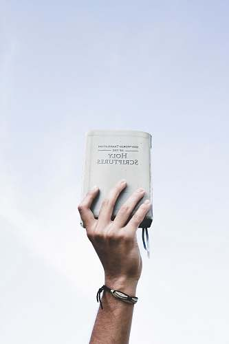 people person holding bible bible