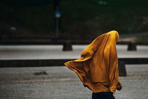 people person wearing yellow jacket human