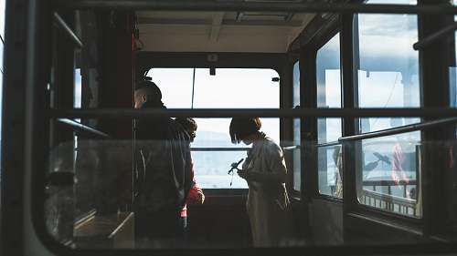 people woman and man inside cable car window