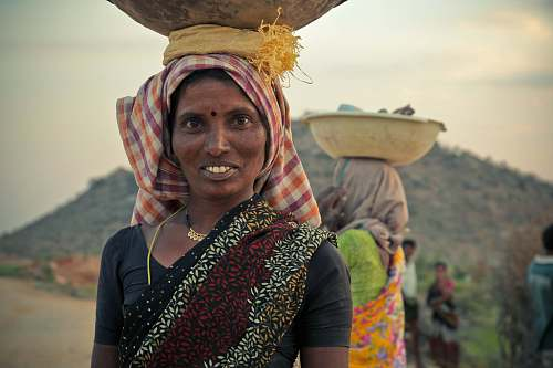 people woman in black top with brown bowl on head india