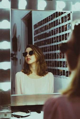 people woman sitting in front of vanity mirror human